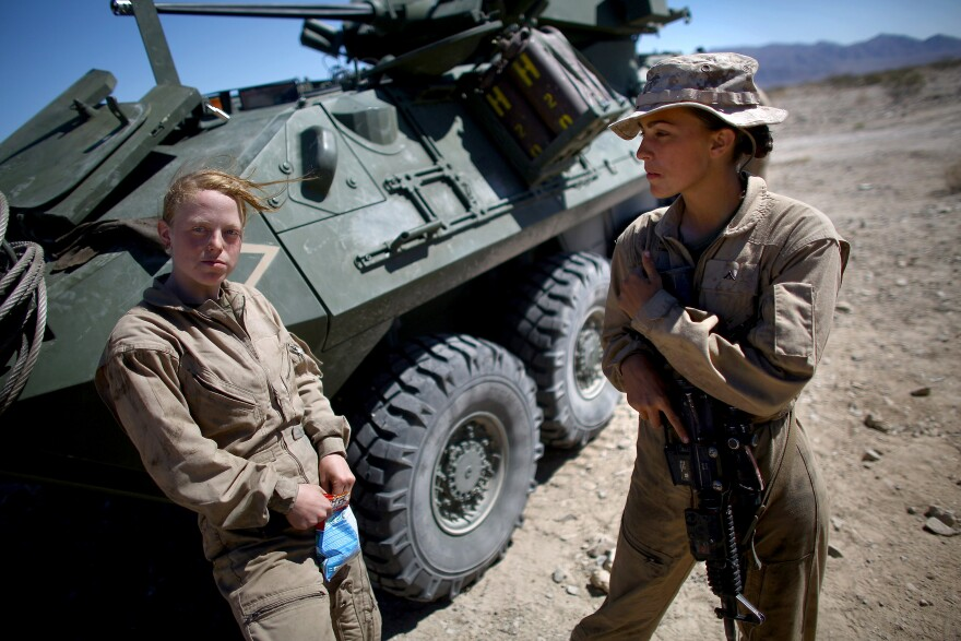 Lance Cpl. Brittany Holloway (left) talks with Brittany Dunklee in front of their LAV-25 vehicle in March at California's Mojave Desert.