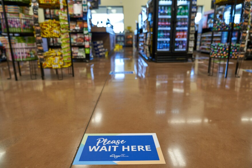 Grocery stores such as Kroger around the United States are using signage, plexiglass barriers and other measures to prevent the spread of the coronavirus disease COVID-19.