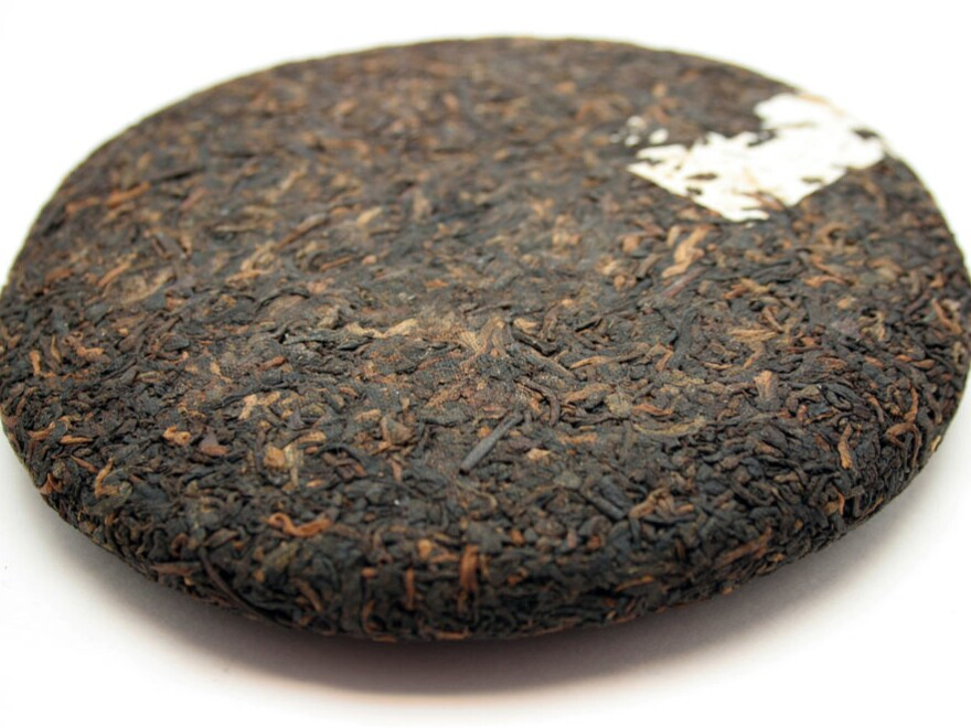 Pu'er is routinely compressed into cakes, called <em>bings</em>, and wrapped in paper printed with the name of the tea.
