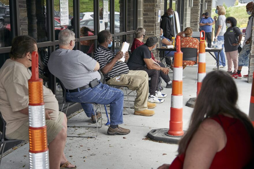 Job seekers exercise social distancing as they wait to be called into the Heartland Workforce Solutions office in Omaha, Neb., July 15, 2020. (Nati Harnik/AP)