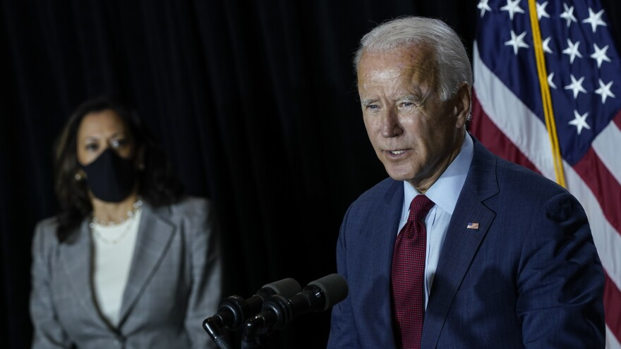 Presumptive Democratic presidential nominee Joe Biden speaks Thursday after a coronavirus briefing with health experts and his newly named running mate, Sen. Kamala Harris, at the Hotel DuPont in Wilmington, Del. Biden took off his mask to speak.