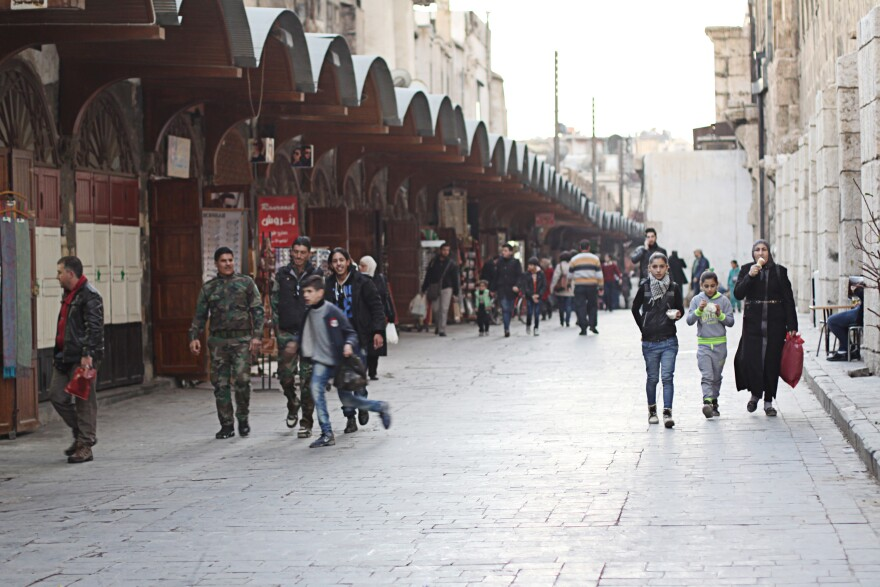 """In central Damascus, it's clear that President Bashar Assad is firmly in control. People close to the regime and government officials say the mood in the city is """"better"""" as regime forces make gains in rebel-held areas."""