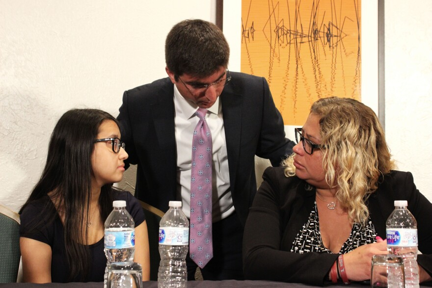 Recent MSD graduate Audrey Diaz (left) speaks with her mother, Iris Diaz (right) and Attorney Solomon Radner (center) after announcing a federal civil rights lawsuit filed by survivors of the Parkland shooting on Wednesday, July 11, 2018.