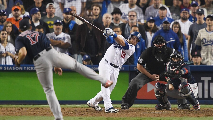"""""""We can't stop here, this is bat country!"""" Max Muncy of the Los Angeles Dodgers hits an 18th inning walk-off home run early Saturday on a pitch from Nathan Eovaldi of the Boston Red Sox to win Game Three of the 2018 World Series at Dodger Stadium."""