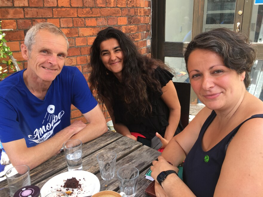 Some of the original members of Extinction Rebellion —<strong> </strong>landscaper David Lambert (from left), town councilor Skeena Rathor and business owner Katerina Hasapopoulos — at the Star Anise cafe in Stroud.