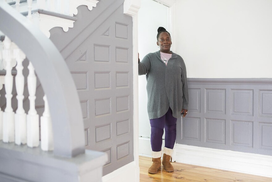 Tawana Lawson inside her new home in JeffVanderLou on December 4, 2019. Lawson has worked with north St. Louis kids for years and will continue her outreach work as part of a rent-to-own agreement with nonprofit LOVEtheLOU.