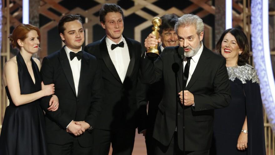 Sam Mendes accepts the award for best drama movie for <em>1917</em> at the Golden Globes on Sunday night.