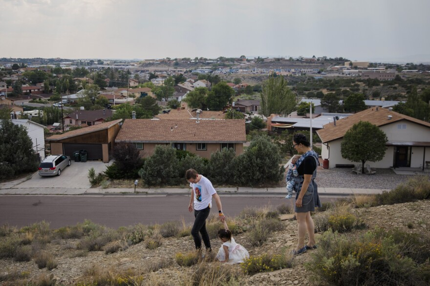 Dr. Chris Hoover (left) and Dr. Connie Liu (right) walk through their home with their children Taro, 3, and Hiro, 4 months, in Gallup, N.M. On a short reporting trip across the Southwest, NPR met very different families and asked them the same simple question: What's been keeping you at night?