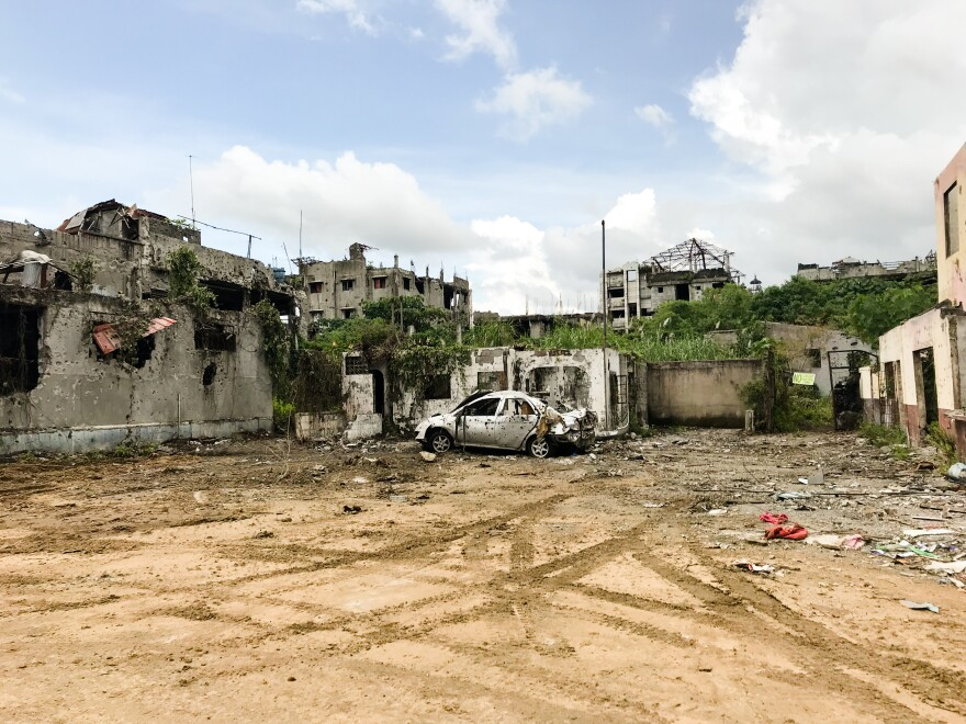 A bullet-ridden car left inside the zone most affected by the ISIS siege in Marawi. The area is a commercial center of about 1 square mile, where more than 6,000 homes, buildings, schools and mosques were destroyed.