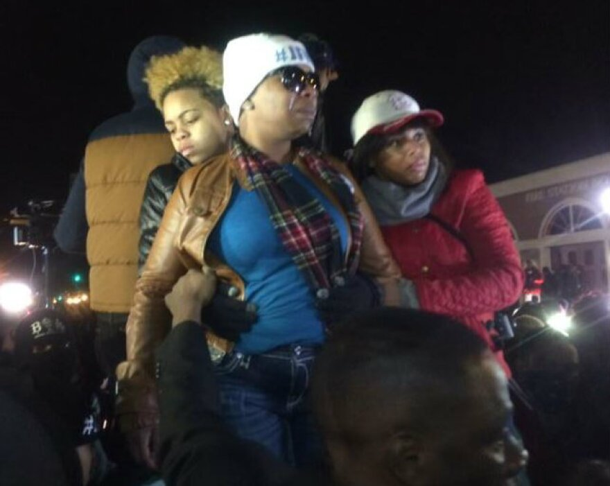 Michael Brown's mother, Leslie McSpadden, in center in blue shirt, hears that Darren Wilson will not be indicted.