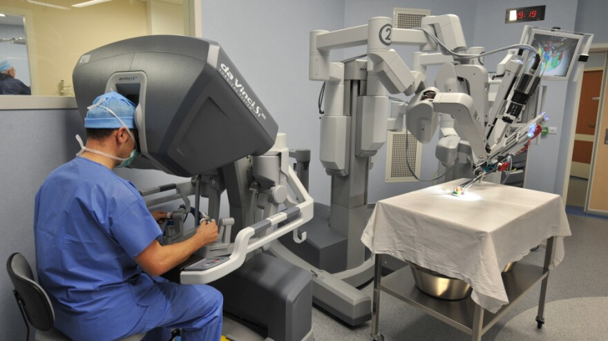 Surgical robots like this one are wildly expensive. Before the economic troubles began, investment in such high-tech medical devices was plentiful. Now, hospitals are looking for comparatively simple solutions to cut costs: streamline medical billing and even investing in $1 catheters that can save upwards of $50,000.