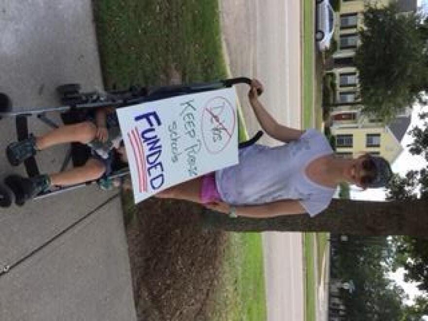 Denise Howard protesting Secretary Betsy DeVos's visit to Leon County.
