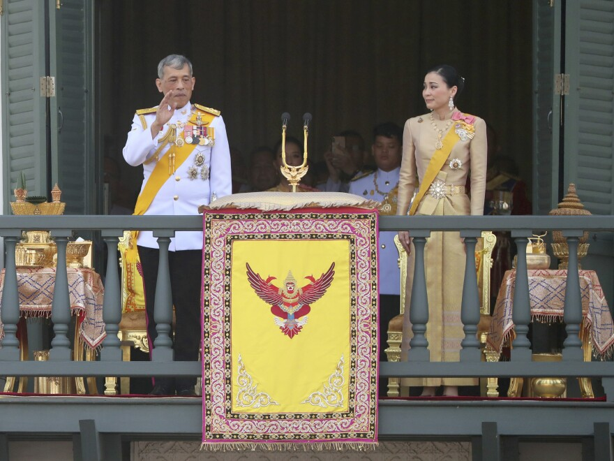 Thailand's King Maha Vajiralongkorn and Queen Suthida greet a public audience during the king's coronation ceremony in May.