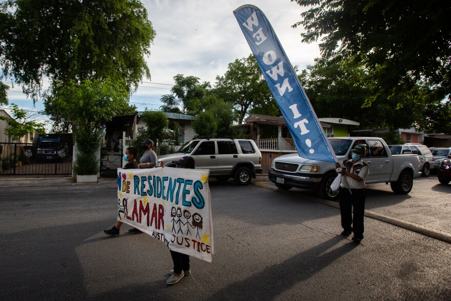North Lamar Mobile Home Park residents celebrate on Saturday a deal they made to purchase the land their homes sit on.