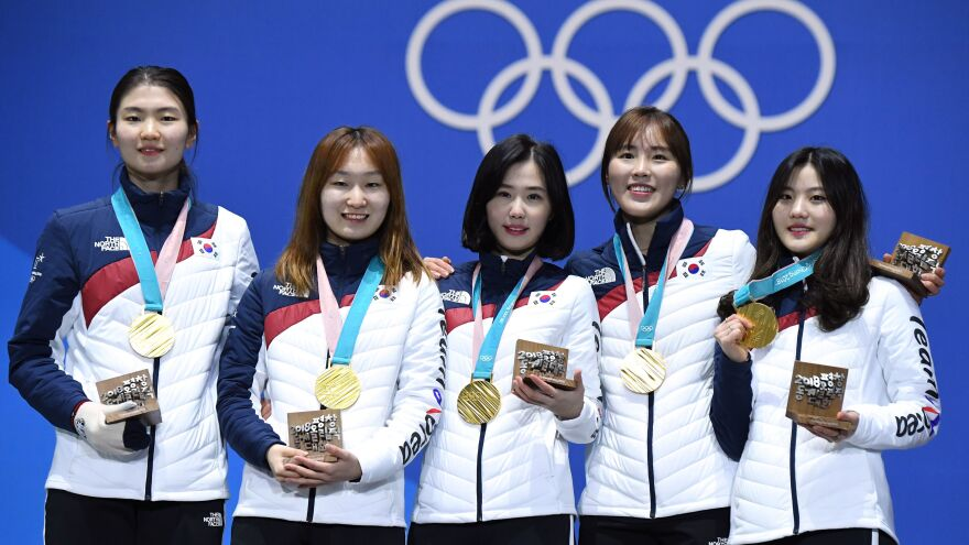 South Korean gold medalist Shim Suk-hee (far left), shown with her relay teammates during the Pyeongchang 2018 Winter Olympic Games, accused her former coach of repeated sexual assault.