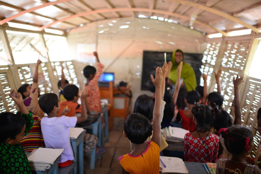 The boat has one classroom that holds about 30 kids. The walls are made of reeds. The lone computer runs off solar panels.