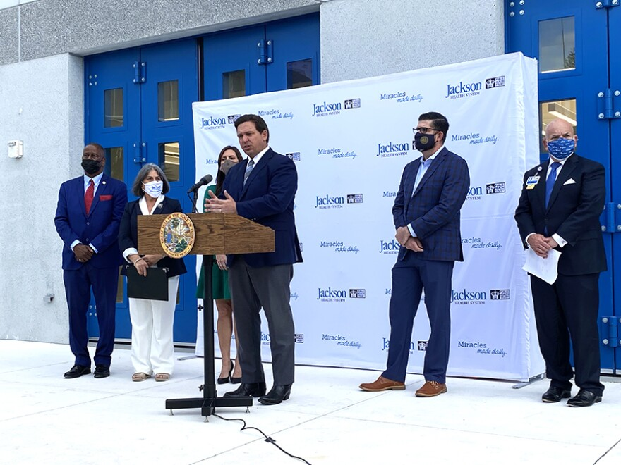 Gov. Ron DeSantis announced efforts to increase vaccinations of people ages 65 and older during a press conference at Jackson Memorial Hospital in Miami on Jan. 4, 2020.