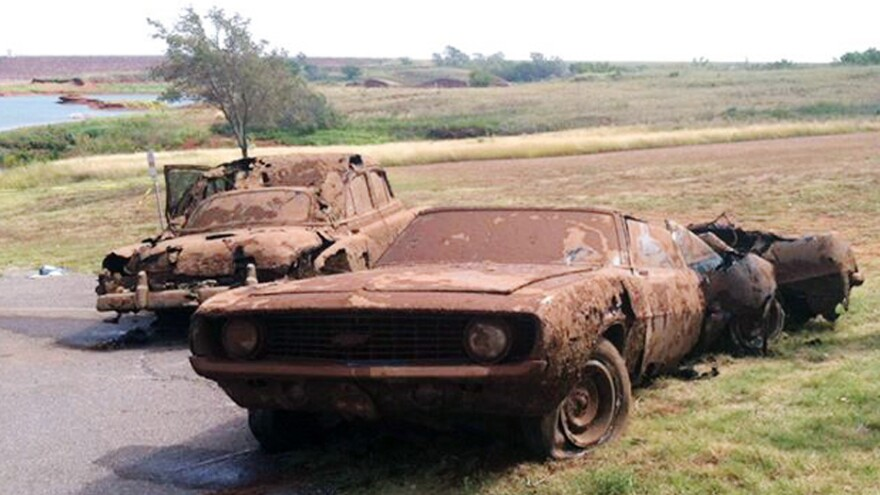 The two cars recovered from Foss Lake in western Oklahoma. Bodies were found inside both. The discoveries may help solve the mysteries of what happened to people who went missing decades ago.