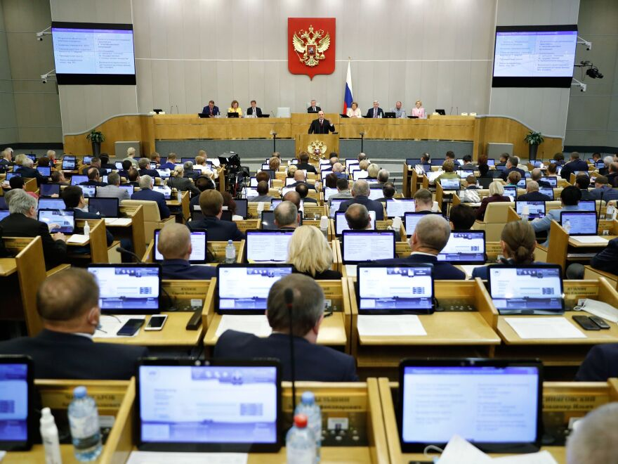 The lower chamber of Russia's parliament, seen here being addressed by Prime Minister Mikhail Mishustin in July, approved a number of bills on Wednesday that restrict online content.