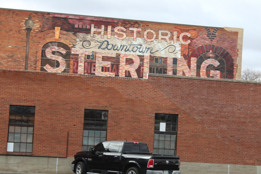 """A mural with the the words """"Historic Downtown Sterling"""" written on it"""