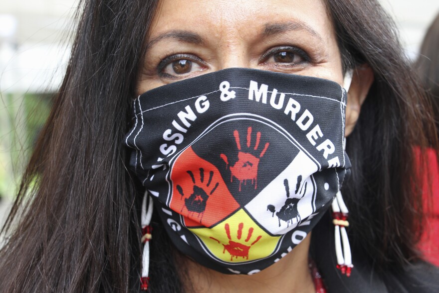 Woman Wearing Missing And Murdered Indigenous Women Mask