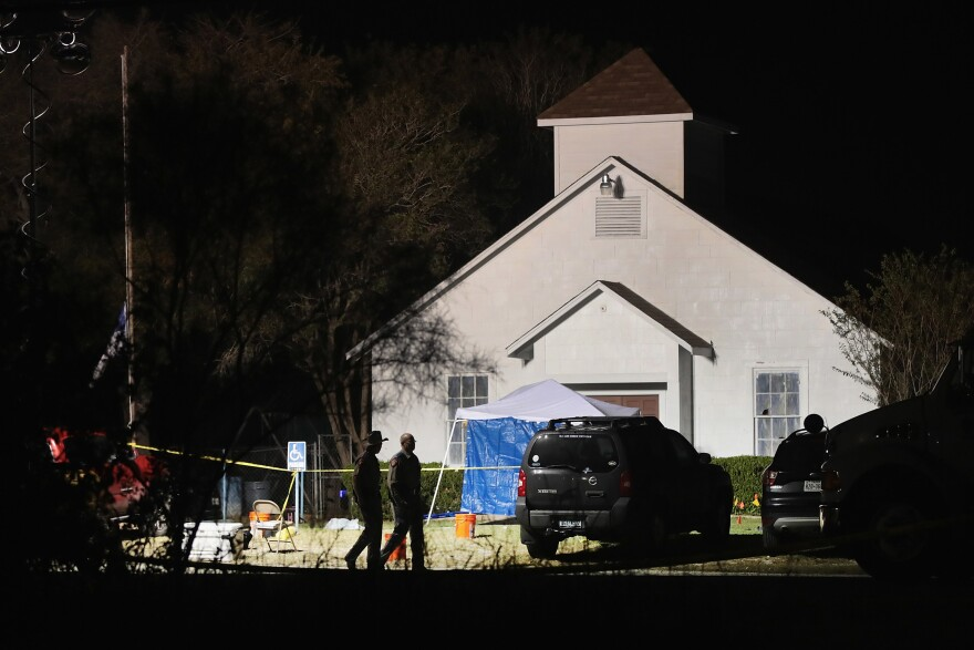 Investigators continued to assess the scene at the church early Monday morning.