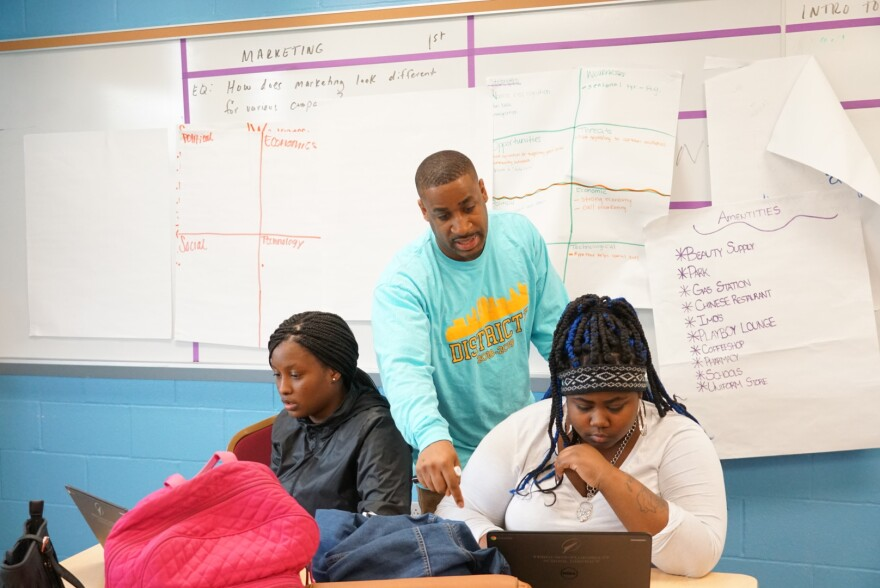 Bradley Johnson speaks with several students in his entrepreneurship course at McCluer South Berkeley who participated in the St. Louis Youth Entrepreneurship Challenge. May 3, 2019