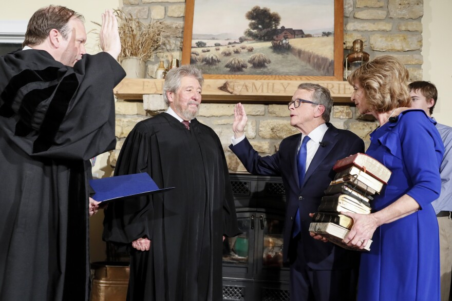 Photo of Gov. Mike DeWine taking oath of office