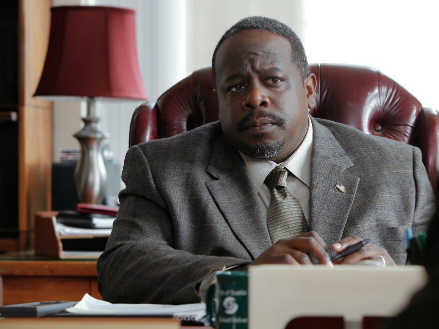 Richard McIver (Cedric the Entertainer) is Cogswell's election opponent, portrayed as the advocate for an undesirable status quo.