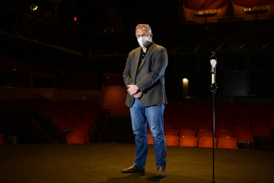 Chris Hansen of Kranzberg Arts Foundation stands on the stage of The Grandel Theatre.