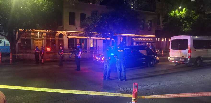 The scene of a shooting Saturday night in downtown Austin, near the corner of Fourth and Congress.