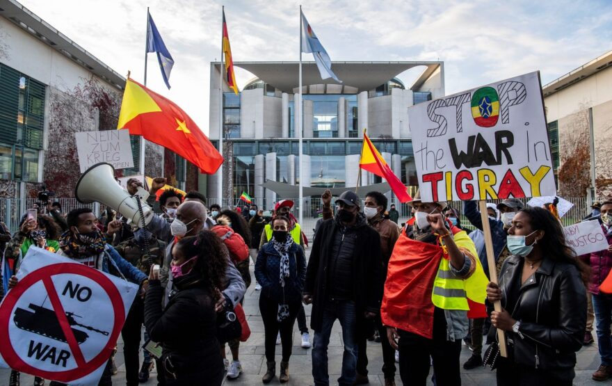 Pro-Tigrayan demonstrators display placards during a protest in Berlin over a week-old conflict in northern Ethiopia between the regional ruling party, the Tigray People's Liberation Front and the government of Prime Minister Abiy Ahmed.