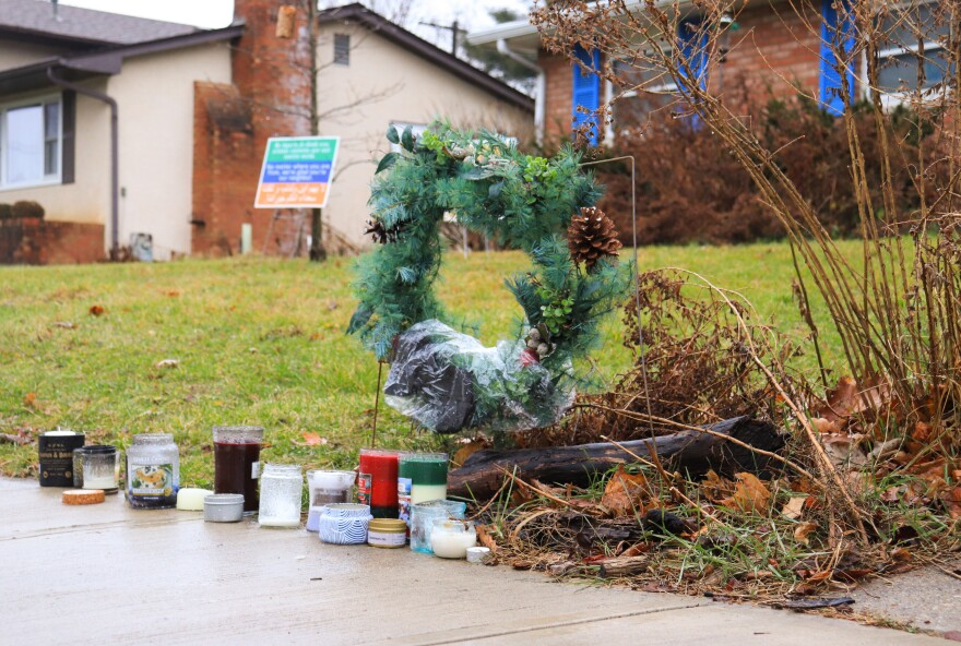 A small memorial has been set up on Oberlin Drive in the yard next door to where Andre Hill was killed.