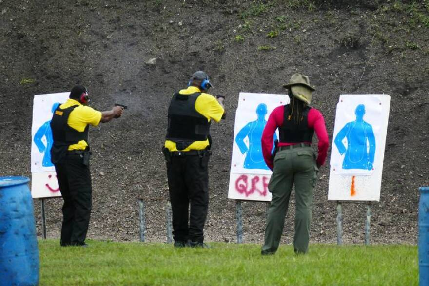 A Broward Sheriff instructor, far right, oversees two of the armed guardian trainees during a firearms training at the BSO shooting range at Markham Park in July. The guardian program is one of several recommendations made by the state MSD commission.