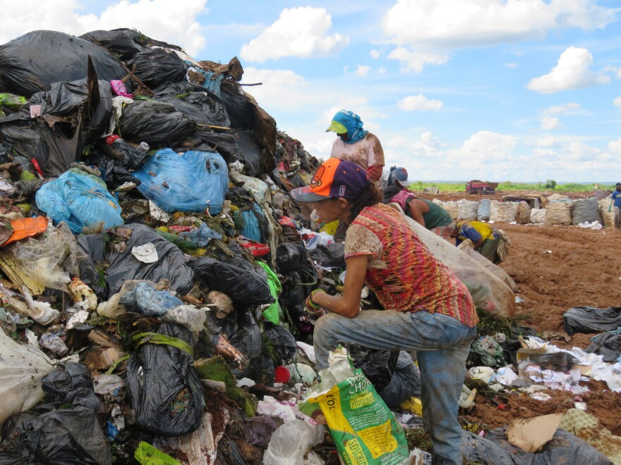 Some 2,000 trash-pickers — known as <em>catadores</em> — survive by fishing out plastics, metal, cardboard and other recyclables from the dump to sell to middlemen. More than half the trash-pickers are women — often single mothers in need of cash to feed their families.