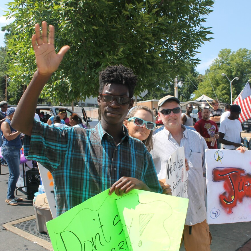 Jay Mattson and his parents, Vicky and Kevin Mattson. The Mattsons traveled from Athens, Ohio, to join the protests in Ferguson.