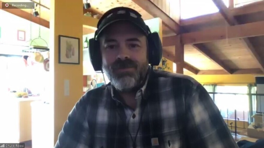 Chuck Rossi, the co-founder of Open Source Defense, at his home in California. He uses video conferences to connect with new gun owners.