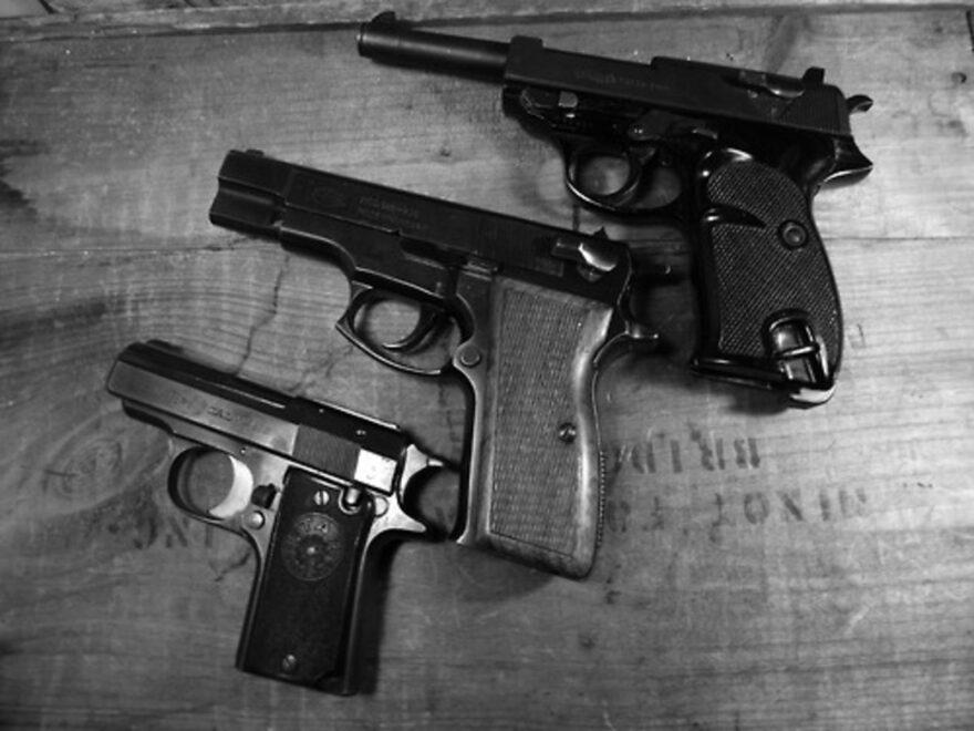 Three handguns, including a Walther P38 pistol.