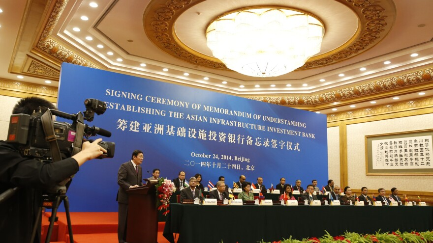 Chinese Finance Minister Lou Jiwei (left) speaks during the signing ceremony of the Asian Infrastructure Investment Bank last year in Beijing.