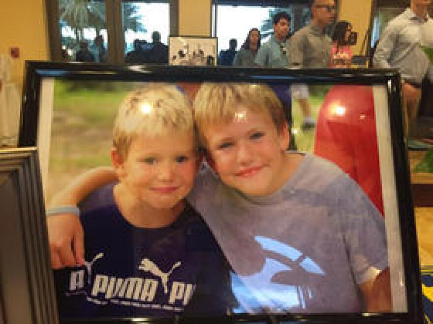 A childhood photo of Nick and his younger brother, Alex.