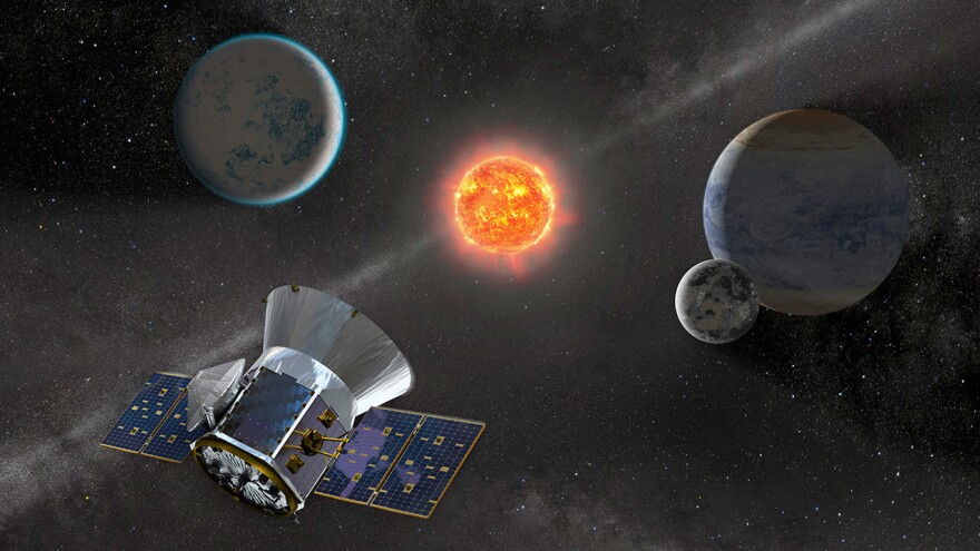 An artist's representation of NASA's Transiting Exoplanet Survey Satellite, or TESS, observing an M dwarf star with orbiting planets.