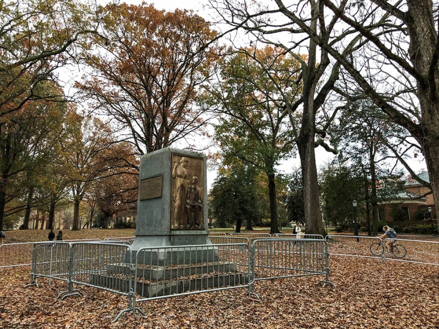 A photo take on December 2, 2018 shows barricades surrounding the pedestal where the Silent Sam statue once stood.