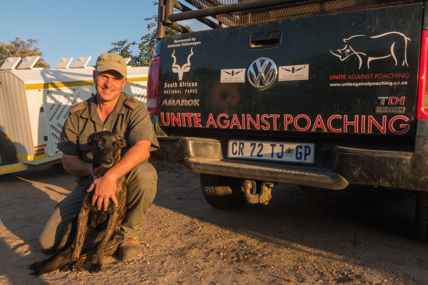 Johan van Straaten, shown above with his dog, Lola, is the lead dog trainer at Southern African Wildlife College.