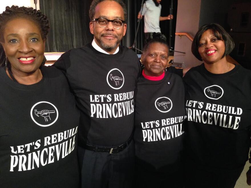 """Linda Joyner, Princeville Mayor Bobbie Jones, Pamela Ransome and Kim Riggins show off their new """"Let's Rebuild Princeville"""" t-shirts. (Leoneda Inge/WUNC)"""