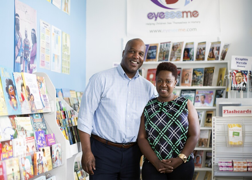 Jeffrey and Pamela Blair pose for a portrait at EyeSee Me.