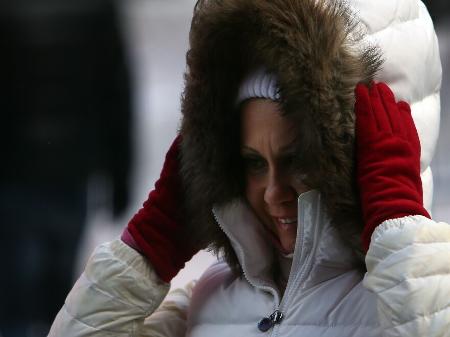 Trying to stay warm: A woman paused in Manhattan's Times Square on Friday as bitterly cold winds blew through. Even colder temperatures are coming for much of the nation.