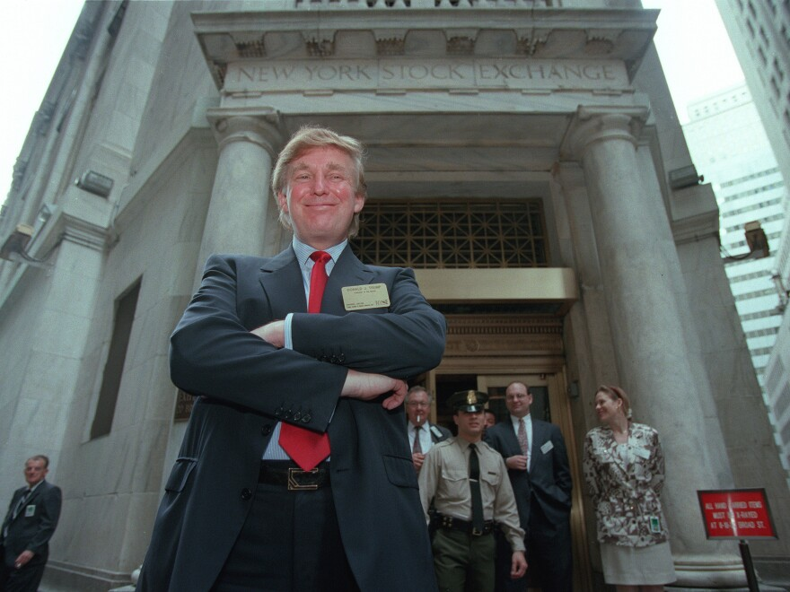 Donald Trump poses for photos outside the New York Stock Exchange in June 1995.
