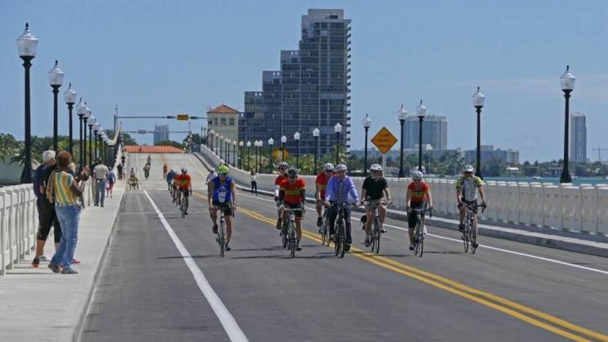 Cyclists ride on the Venetian Causeway bridge just before it reopens to car traffic after nine months of construction in 2016.