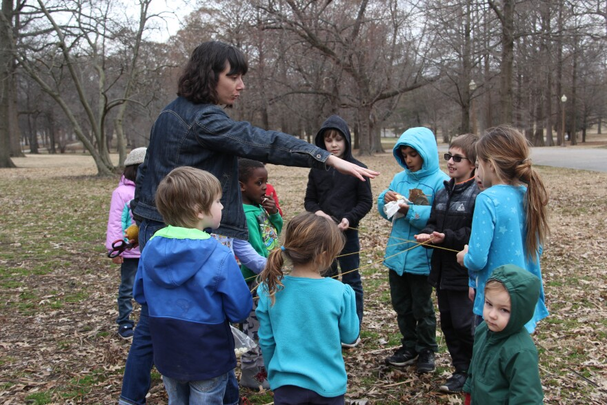 St. Louis outdoor educator Cara Murphy teaching children in Tower Grove Park about the food web.
