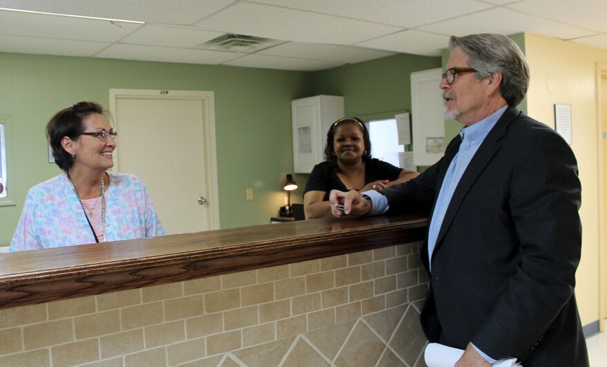 Mike Morrison talks with two staff members at Bridgeway's detox center in St. Louis.
